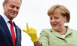 German Chancellor Merkel jokes with Poland's Prime Minister Tusk