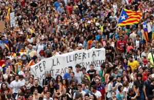 People take part in a demonstration two days after the banned independence referendum in Barcelona